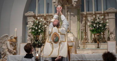 Priest consecrating the host in latin mass